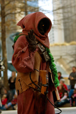 larger than life: Atlanta, GA, USA - December 1, 2012:  A Jawa character from the Star Wars movies walks down Peachtree Street while taking part in the annual Atlanta Christmas parade in downtown Atlanta.