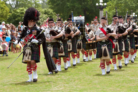 bagpipes: Atlanta, GA, USA - May 25, 2012: A drum major leads a local bagpipes group in opening the GREAT festival, a spring festival celebrating Great Britain and the United Kingdom, on the grounds of Oglethorpe University. Editorial