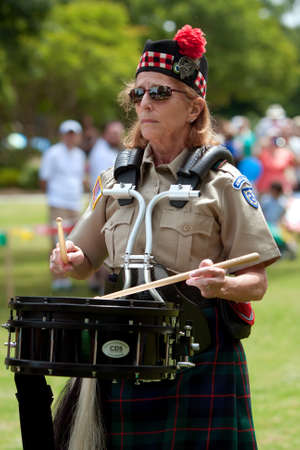 Atlanta, GA, USA - May 25, 2012: An unidentified woman plays the drums at the GREAT festival, a spring festival celebrating Great Britain and the United Kingdom, on the grounds of Oglethorpe University.