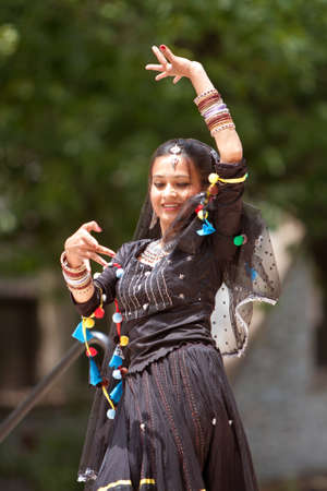 tassles: Atlanta, GA, USA - May 25, 2012:  A female Indian dancer performs at the GREAT festival, a spring festival celebrating Great Britain and the United Kingdom.