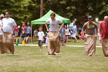 Atlanta, GA, USA - May 25, 2012:  Several unidentified men compete in a sack race at the GREAT festival, a spring festival celebrating Great Britain and the United Kingdom.
