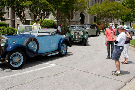 Atlanta, GA, USA - May 25, 2012:  Unidentified people admire Rolls Royce cars on display at the GREAT festival, a spring festival celebrating Great Britain and the United Kingdom.