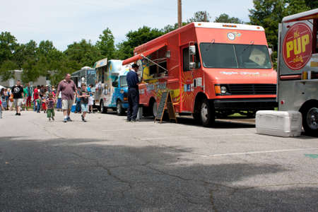 truck: Atlanta, GA, USA - May 25, 2012:  Patrons buy food from food trucks at the GREAT festival, an event celebrating Great Britain and the United Kingdom.