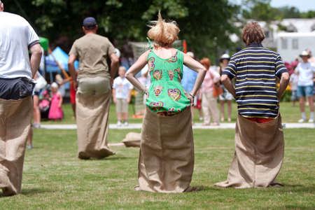Atlanta, GA, USA - May 25, 2012:  Several unidentified people compete in a sack race at the GREAT festival, a spring festival celebrating Great Britain and the United Kingdom. Editorial