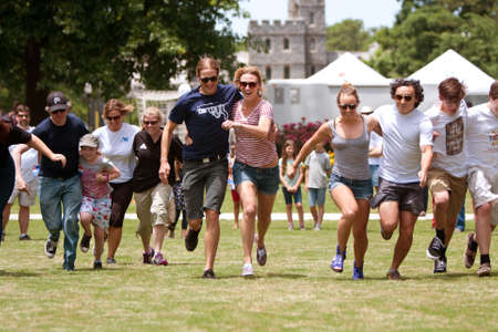 Atlanta, GA, USA - May 25, 2012:  Several people run in the arm-in-arm race at the GREAT festival, a spring festival celebrating Great Britain and the United Kingdom. Editorial