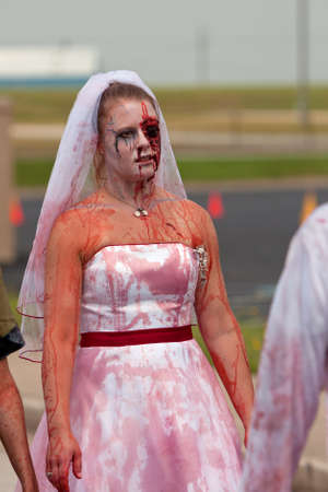 Atlanta, GA, USA - June 8, 2013:  A blood soaked zombie bride walks in the Atlanta Zombie Run, a 5K run and walk where hundreds of runners dodged zombies during the race.