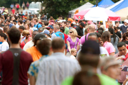 Atlanta, GA, USA - July 27, 2013:  A huge crowd gathers in Piedmont Park for the 3rd annual Atlanta Ice Cream Festival.  The event was free and open to the public.