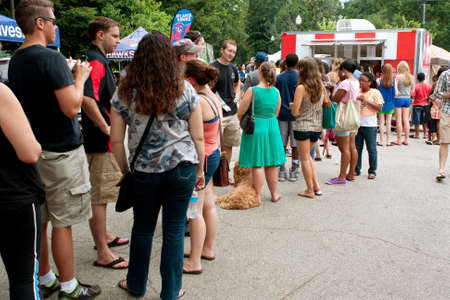 Atlanta, GA, USA - July 27, 2013:  A crowd of people wait in line to buy ice cream at the 3rd Annual Atlanta Ice Cream Festival at Piedmont Park.  The event was free and open to the public.  新聞圖片