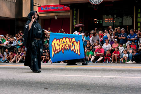 memorable: Atlanta, GA, USA - August 31, 2013:  A crowd of spectators lines Peachtree Street in downtown Atlanta as the start of the Dragon Con parade passes by.  Editorial