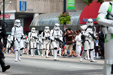 Atlanta, GA, USA - August 31, 2013:  A group of Star Wars storm troopers walks by spectators at the annual Dragon Con parade on Peachtree Street.  新聞圖片