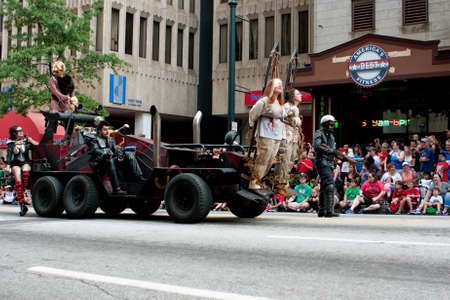 documenting: Atlanta, GA, USA - August 31, 2013:  A vehicle from the Road Warrior movie, with human shields out front, terrorizes the crowd at the Dragon Con parade.  Editorial