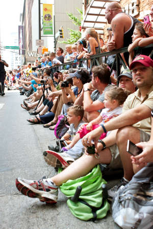 documenting: Atlanta, GA, USA - August 31, 2013:  A large crowd of spectators lines Peachtree Street in downtown Atlanta, to watch the annual Dragon Con parade pass by. Editorial