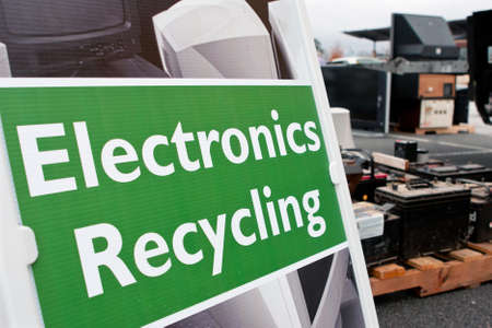 Lawrenceville, GA, USA - November 23, 2013:  An Electronics Recycling sign marks the spot for people to drop off old computers, TVs , etc. at Gwinnett Countys America Recycles Day event.  Editorial