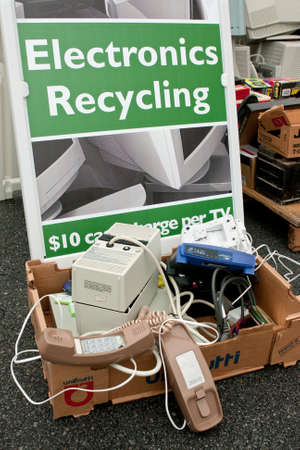 Lawrenceville, GA, USA - November 23, 2013:  An Electronics Recycling sign marks the spot for people to drop off old phones, computer monitors, etc. at Gwinnett Countys America Recycles Day event. Editorial
