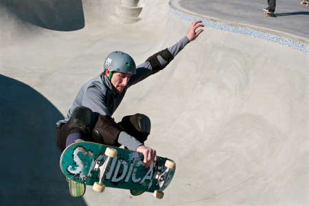 elbow pads: Kennesaw, GA, USA - November 24, 2013:  A veteran skateboarder catches air in the bowl during Old Man Sundays, as part of the grand opening weekend of the brand new Kennesaw Skateboard Park. Editorial
