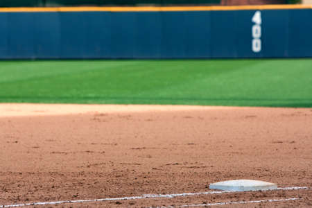 Empty baseball field highlights first base and outfield wall Stock Photo - 27582858