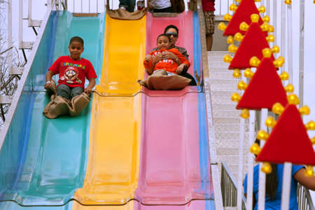 Atlanta, GA, USA - March 15, 2014:  A family slides down the fun slide at the annual Atlanta Fair. Editorial