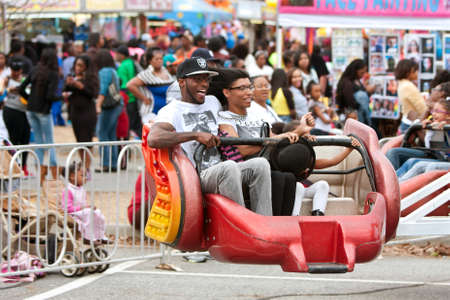 adrenaline rush: Atlanta, GA, USA - March 15, 2014:  A family laughs while riding a fast-moving carnival ride at the annual Atlanta Fair.