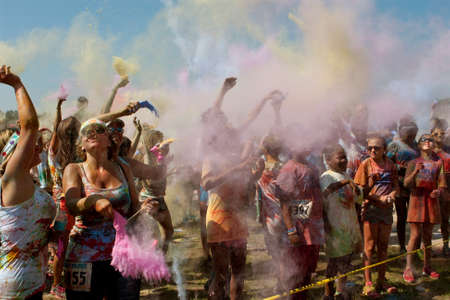 Lawrenceville, GA, USA - May 31, 2014:  People throw packets of colored corn starch in the air to get doused in color at Bubble Palooza. Editorial