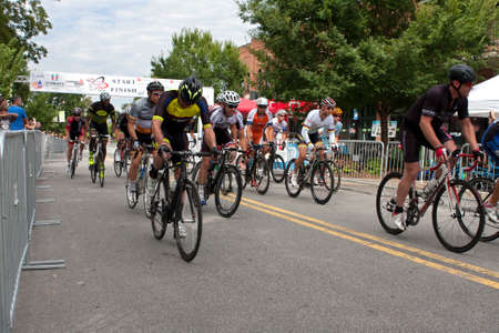 adrenaline rush: Duluth, GA, USA - August 2, 2014:  A group of cyclists sprint from the starting line as they compete in the Georgia Cup Criterium event.