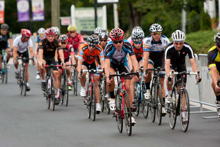 adrenaline rush: Duluth, GA, USA - August 2, 2014:  Cyclists bunched together in a pack compete in the Georgia Cup, a criterium event held on the streets of downtown Duluth.