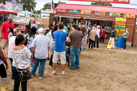 Hampton, GA, USA - September 27, 2014:  People wait in long line to order food from a concessions vendor at the Georgia State Fair. Editorial