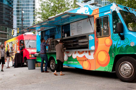 thursday: Atlanta, GA, USA - October 16, 2014:  Customers order meals from a popular food truck during their lunch hour, at Food Truck Thursday in Atlanta.