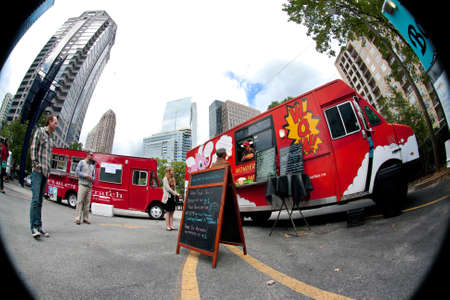 thursday: Atlanta, GA, USA - October 16, 2014:  Fish eye view of customers standing in line to order meals from food trucks during their lunch hour, at Food Truck Thursday in Atlanta.