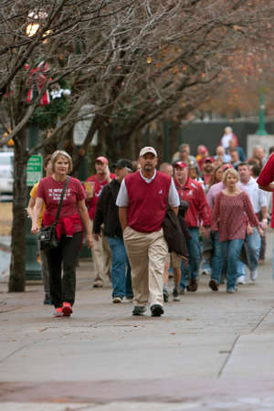 Atlanta, GA, USA - December 6, 2014:  University of Alabama fans walk through Centennial Park on their way to the Georgia Dome to watch the SEC Championship game against Missouri.