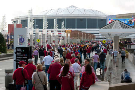 Atlanta, GA, USA - December 6, 2014:  Hundreds of University of Alabama fans dressed in crimson walk toward the Georgia Dome to watch the SEC Championship game against Missouri.