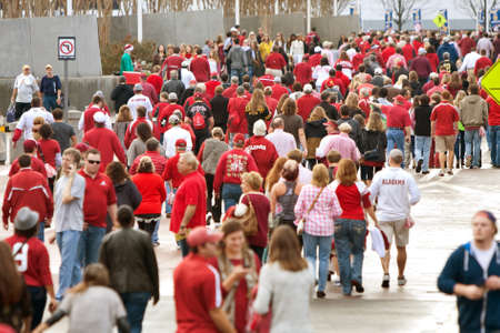 contingent: Atlanta, GA, USA - December 6, 2014:  Thousands of Alabama fans dressed in crimson walk toward the Georgie Dome to watch the SEC Championship game against Missouri.