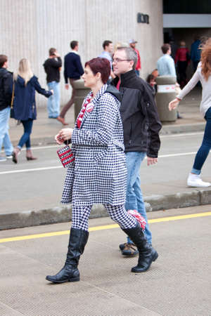contingent: Atlanta, GA, USA - December 6, 2014:  A confident female University of Alabama fan dressed head to toe in houndstooth, walks toward the Georgia Dome to watch the SEC Championship game against Missouri.