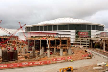 progressive art: Atlanta, GA, USA - December 6, 2014:  The construction site of the new Atlanta Stadium sits next to the Georgia Dome.  The new stadium is scheduled to open following the 2016 NFL season.