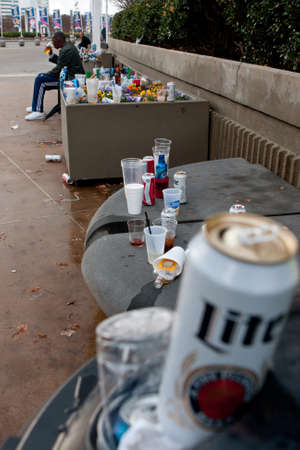 Atlanta, GA, USA - December 6, 2014:  Beer cans and liquor bottles left as trash litter the landscape near the Georgia Dome during the SEC Championship game.