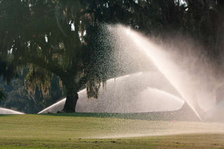 wetting: Sprinklers Soak A Golf Course Fairway