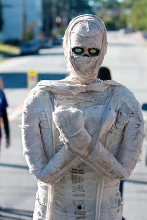 scaring: Decatur, GA, USA - October 4, 2014:  A robotic mummy on wheels moves around scaring patrons attending the annual Maker Faire Atlanta. Editorial