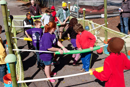 inventive: Decatur, GA, USA - October 4, 2014:  Kids and adults play a game of human foosball at the annual Maker Faire Atlanta.