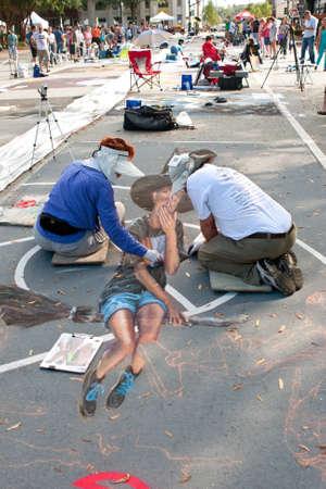 dexterity: Marietta, GA, USA - October 11, 2014:  Chalk artists draw a Halloween scene on a downtown street as part of the Marietta Chalkfest.