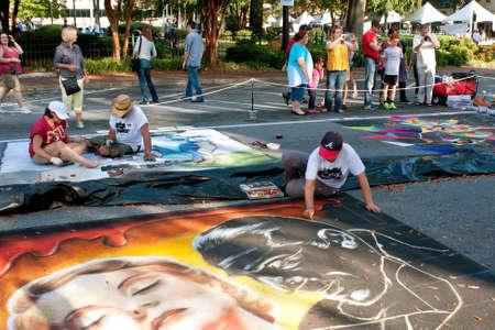dexterity: Marietta, GA, USA - October 11, 2014:  Chalk artists sketch elaborate Halloween scenes on a downtown street as part of the Marietta Chalkfest. Editorial