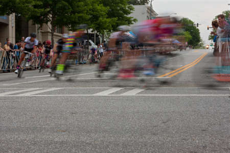 bunched: Athens, GA, USA - April 25, 2015:  Motion blur of male cyclists turning a corner in an amateur race on city streets, in the annual Athens Twilight Criterium.