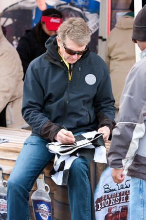 legend: Hampton, GA, USA - February 28, 2015:  NASCAR legend Bill Elliott signs autographs outside Atlanta Motor Speedway before a NASCAR race.