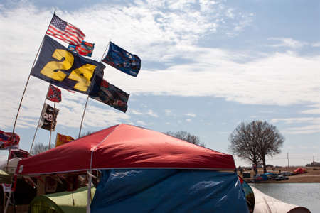 nascar: Hampton, GA, USA - February 28, 2015:  Fans fly the flags of their favorite NASCAR drivers as they camp in tents outside Atlanta Motor Speedway before a weekend of races.