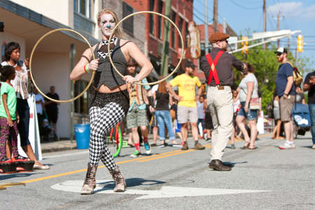 adrenaline rush: Atlanta, GA, USA - May 2, 2015:  Street performers with the Imperial OPA Circus entertain patrons walking by at the Fire In The Fourth festival in Atlanta.