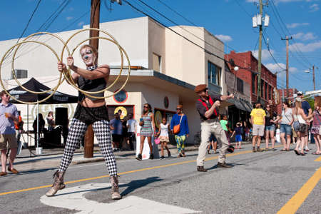 adrenaline rush: Atlanta, GA, USA - May 2, 2015:  Street performers with the Imperial OPA Circus entertain people walking by at the Fire In The Fourth festival in Atlanta. Editorial