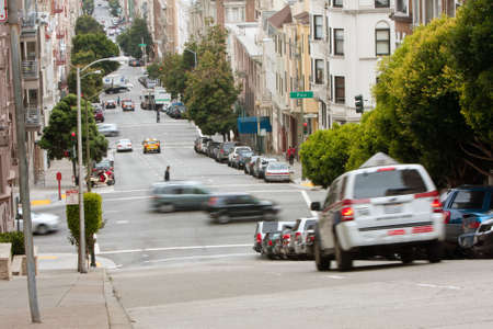 San Francisco, CA, USA - May 18, 2015:  Cars motion blur travelling through extremely hilly streets in the Nob Hill area of San Francisco.