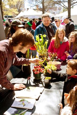 Atlanta, GA, USA - March 28, 2015:  An instructor explains facts about carnivorous plants to kids and families looking at a display at the Atlanta Science Fair at Centennial Park in Atlanta.