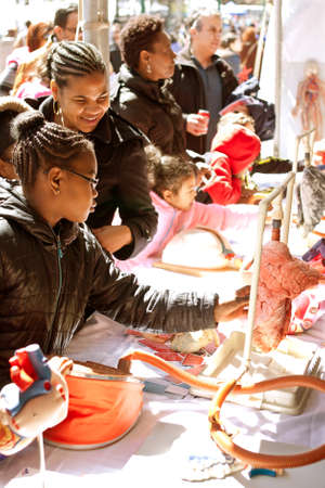 see the usa: Atlanta, GA, USA - March 28, 2015:  Students touch a real human lung and see how it works at a biology display at the Atlanta Science Fair in Centennial Park in Atlanta.