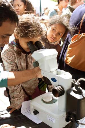 fair: Atlanta, GA, USA - March 28, 2015:  A young student looks through a digital microscope at the Atlanta Science Fair at Centennial Park in Atlanta.