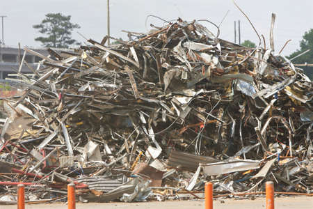 trashed: A huge pile of debris and twisted metal is stacked on the demolition site of a long-abandoned auto assembly plant Stock Photo