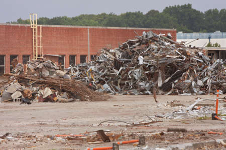 trashed: Debris piles of twisted metal and junk are stacked high at the demolition site of an auto assembly plant